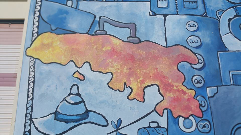 Detail of mural on the side of the Biblioteca di Lampedusa per bambini e ragazzi, Via Roma